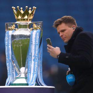 pundit-jake-humphry-with-premier-league-trophy